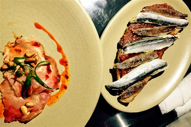 Cured tuna with chili oil and Marcona almonds and an anchovy and boquerones montadito at Morcilla  in Lawrenceville.