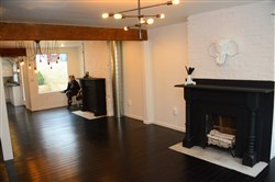 The fireplace mantels in 1214 James St. have been painted matte black for a modern feel.