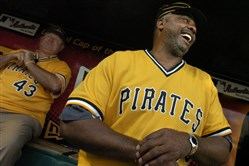 Ex-Pittsburgh Pirate Dave Parker shares a laugh with 1979 teammate Don Robinson (back) in 2004. A since-deleted tweet sent Thursday from an account that appears to be run by Pirates clubhouse manager Scott Bonnett hinted at new uniforms in this style for 2016.