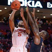 Clemson forward Jaron Blossomgame shoots against Pitt's Michael Young in the Tigers' win Wednesday night in Greenville, S.C.