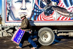 Kraig Moss, a supporter of Republican presidential candidate Donald Trump, outside a truck with a Trump painting. The Democratic and Republican Iowa caucuses, the first step in nominating a presidential candidate from each party, will take place Monday.