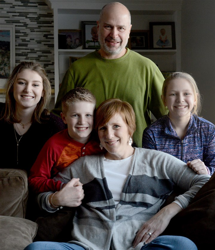 20160128MWHcancerLocal02-1 Carrie Martin, 44, with her husband, Al, 51, and their three children: Alex, 16, Drew, 12, and Will, 8, at their home in Whitehall. Ms. Martin was diagnosed with triple-negative breast cancer late in 2008, with metastases diagnosed in July 2010.