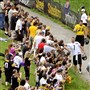 Quarterback Ben Roethlisberger greets fans as he walks to the practice field at Steelers training camp at Saint Vincent College in 2014.