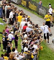Quarterback Ben Roethlisberger greets fans as he walks to the practice field at Steelers training camp at Saint Vincent College in 2014. Original Filename: 20140727radSteelersCampSpts.1.jpg