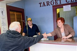 Jack Cargnoni, left, of Mount Washington, wishes Jacqueline Longo luck at Target Cleaners in Heidelberg on Jan. 29. The cleaners, owned by James and Jacqueline Longo, is closing its doors after being in business since 1952.