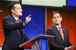 Presidential candidate and Texas Sen. Ted Cruz answers a question Thursday at the Republican presidential debate in Des Moines, Iowa, as Florida Sen. Marco Rubio looks on.
