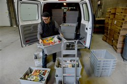 Gene Magnani unloads books from a van at the Carnegie Library of Pittsburgh Library Support Center. On a weekly basis,  80,000 library items are sorted for return back to the various branches of the Carnegie Library.