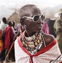 Mary Rimas of the Olorgesailie Maasai women's artisan group in Kenya wearing accessories from the OMWA + Idia'Dega collection.