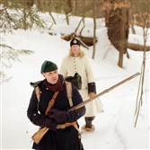 Bob Bearor, dressed as a French colonial officer of the French and Indian War, and his wife, Holly, walk an Indian trail outside Ticonderoga, N.Y., that was used during the war in this photo taken Feb. 13, 2003. Visitors to the Fort Necessity encampment in Fayette County next weekend may expect to see re-enactors in similar garb.