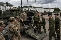 Lithuanian soldiers inspect a Stryker armored vehicle belonging to the Pennsylvania National Guard during opening ceremonies for Saber Strike 2015 military exercises in Rukla, Lithuania, on June 8, 2015.