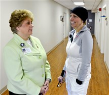 Carolyn Izzo, left, president and CEO of Ellwood City Hospital, speaks with Patty Royle, a clinical nurse.