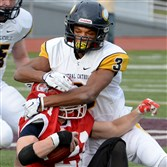 Central Catholic's Damar Hamlin takes down Cumberland Valley's Nicholas Rhodes during a game last season in Altoona.