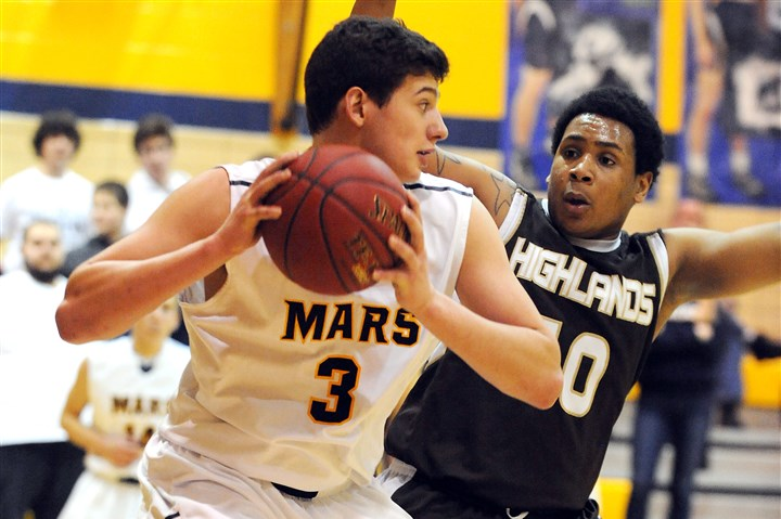 20150127bwMarsBoysZSports04-3 Despite being a standout football player, John Castello of Mars Area will pursue basketball in college because of a fear of concussions and head injuries.