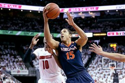 Virginia guard Malcolm Brogdon shoots Saturday in a victory against Louisville at KFC Yum! Center in Kentucky.