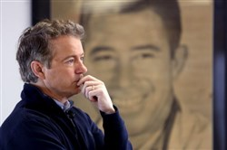 Sen. Rand Paul waits to be introduced at a campaign event in Knoxville, Iowa on Friday.