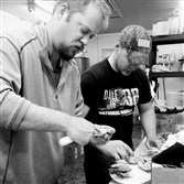 Deep Creek Seafood proprietor Nate Beachler and employee Jesse Paugh shuck oysters in the kitchen of the Mt. Lebanon native's new restaurant in Oakland, Md.