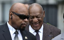Actor and comedian Bill Cosby, right, smiles as he arrives for a court appearance on Feb. 3 in Norristown, Pa.