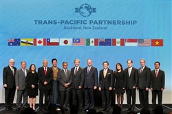 New Zealand Prime Minister John Key, center, joins ministers from 12 countries after the signing of the Trans-Pacific Partnership on Wednesday at Sky City in Auckland, New Zealand.