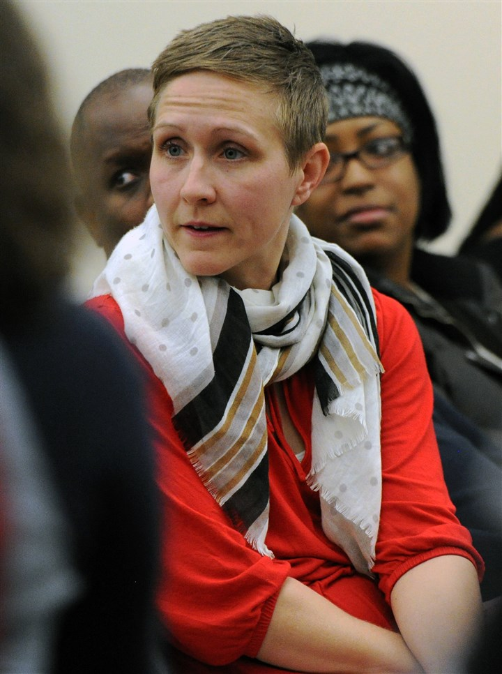 20160203JHLocalAPA03-2 Emily Sawyer, center, of Wilkinsburg, listens as residents speak during the meeting.