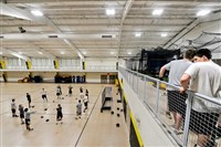 North Allegheny holds its voluntary baseball winter training at the indoor facility at the high school. In the bottom left, pitchers stretch; one floor above, players wait to bat in the cages.