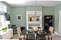 The owners chose aqua to complement the white fireplace mantel and woodwork in the dining room.