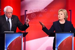 Presidential candidates Bernie Sanders and Hillary Clinton participate in the MSNBC Democratic Candidates Debate on Thursday at the University of New Hampshire in Durham.