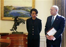 Condoleezza Rice, left, the Bush administration's national security adviser, with Secretary of State Colin Powell in the Oval Office of the White House in Washington, D.C., on Feb. 25, 2004.