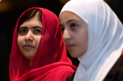 Nobel Peace Prize winner Malala Yousafzai, left, from Pakistan and 17-year-old Syrian refugee Mazoun Almellehan, during the first focus event on education at the 'Supporting Syria and the Region' conference at the Queen Elizabeth II Conference Centre in London, Thursday