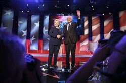 Hillary Clinton and Sen. Bernie Sanders of Vermont arrive on stage for the Democratic presidential primary debate hosted by MSNBC at the University of New Hampshire in Durham, N.H., Feb. 4, 2016.