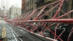 One person died and two others were seriously injured when a crane collapsed in New York City.