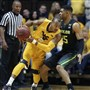 West Virginia guard Jevon Carter looks to make a pass while being guarded by Baylor guard Al Freeman (25) in the first half Saturday in Morgantown, W.Va.