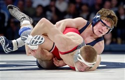 Penn State's Jimmy Gulibon, right, controls Ohio State's Micah Jordan in the 141 pound bout during an NCAA wrestling match, Friday, at the Bryce Jordan Center in University Park, Pa.