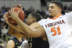 Pitt's Chris Jones and Virginia's Darius Thompson fight for a rebound in the first half Saturday at Petersen Events Center.