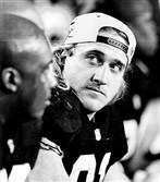 Kevin Greene watches a replay on the scoreboard in the third quarter during Super Bowl XXX in 1995.