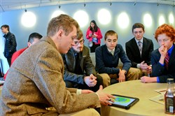Daniel Crawford, left, a senior at Central Catholic High School, goes through the presentation with fellow students in the Pennsylvania Junior Academy of Science Meeting at Duquesne University on Saturday.