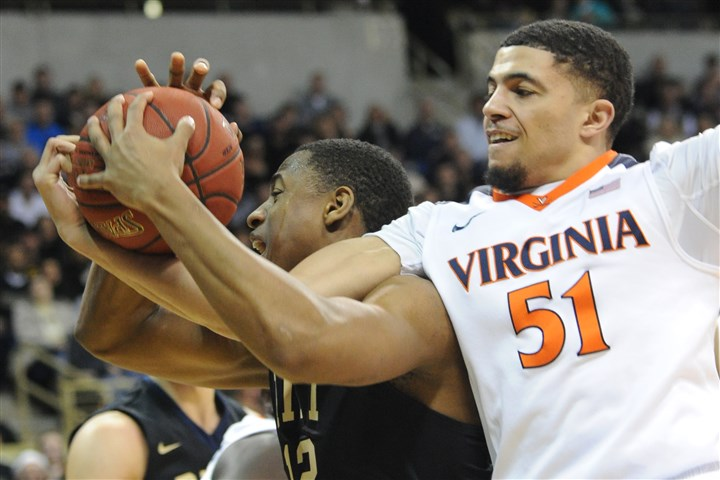 20160206lf-Bball02-1 Pitt's Chris Jones grabs a rebound from Virginia's Darius Thompson in the first half.