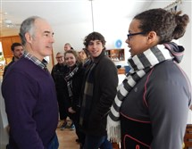 U.S. Sen. Bob Casey, D-Pa., left, greets volunteers for the Hillary Clinton campaign, including Ngiste Abebe, 28, right. Mr. Casey gave volunteers a pep talk Sunday morning at the home of Jerry and Jane Boyer in Bedford, N.H.
