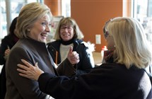 Democratic presidential candidate Hillary Clinton meets with customers Sunday, Feb. 7, 2016, at a Dunkin' Donuts in Manchester, N.H. (AP Photo/Matt Rourke)