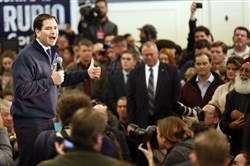 Republican presidential candidate Sen. Marco Rubio, R-Fla., works to charge up a crowd during a campaign stop in a high school cafeteria Sunday in Londonderry, N.H.