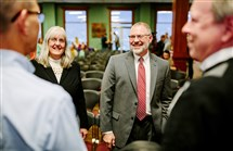 Calvin Troup and his wife Amy talk to faculty and staff after a ceremony announcing him as the new president of Geneva College in Beaver Falls.
