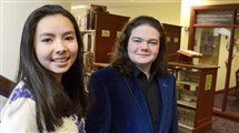 Juniors Cherisse Tompkins and Haydon Alexander pose in the library of the Winchester-Thurston H.S.