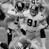Chad Brown, left, and Kevin Greene, right, celebrate after sacking Houston Oilers quarterback Chris Chandler in 1995.