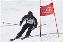 Alexander Reder makes a tight turn at a gate on his first run in the advanced class alpine skiing at last year's Pennsylvania Special Winter Olympics at Seven Springs Mountain Resort.