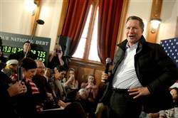 Republican presidential candidate and Ohio Gov. John Kasich campaigns at the Searles School and Chapel  in Windham, N.H. Candidates were in a last push for votes ahead of the first-in-the-nation primary today.