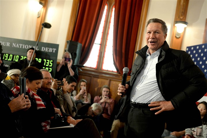 Kasich0209-3 Republican presidential candidate and Ohio Gov. John Kasich campaigns at the Searles School and Chapel in Windham, N.H. Candidates were in a last push for votes ahead of the first-in-the-nation primary today.