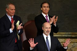 Gov. Tom Wolf, center, delivers his budget address for the 2016-17 fiscal year to a joint session of the Pennsylvania House and Senate, as the speaker of the state House of Representatives, state Rep. Mike Turzai, R-Allegheny, left, and Lt. Gov. Mike Stack, right, listen and applaud at the State Capitol in Harrisburg.