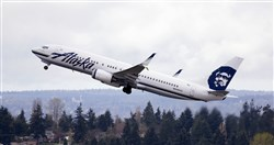 In this photo taken March 24, 2015, an Alaska Airlines jet takes off at Seattle-Tacoma International Airport in SeaTac, Wash.