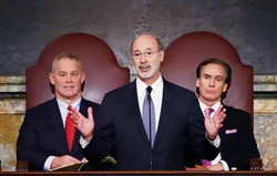 Gov. Tom Wolf, center, delivers his budget address for the 2016-17 fiscal year to a joint session of the Pennsylvania House and Senate on Tuesday in Harrisburg. In the background is House Speaker Mike Turzai, R-Allegheny, left, and Lt. Gov. Mike Stack.