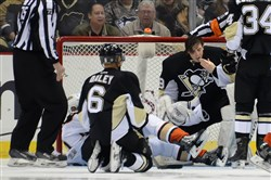Penguins goalie Marc-Andre Fleury checks for blood after having his mask knocked off in the third period against the Anaheim Ducks at Consol Energy Center.