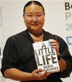 "Author Hanya Yanagihara with her book, ""A Little Life."""